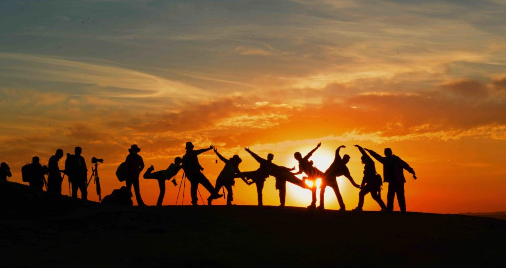 hope source group of people dancing sunset