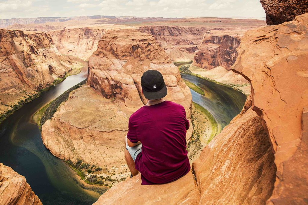 calling and pain man looking into distance horseshoe bend arizona