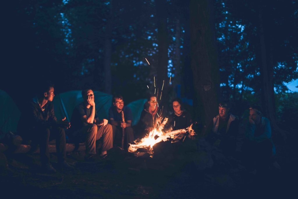 friendships weakness group of people bonfire woods camping trip