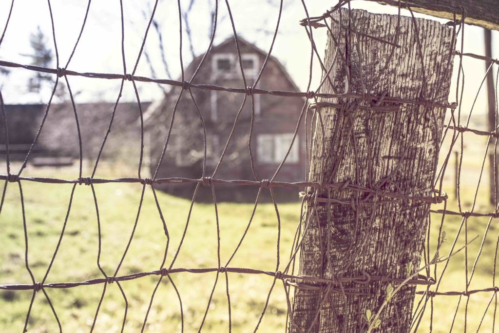 adversity obstacle opportunity barbed wire fence farm barn