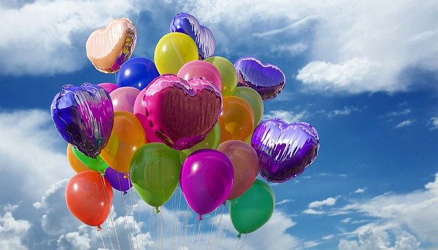celebration colorful balloons blue sky clouds